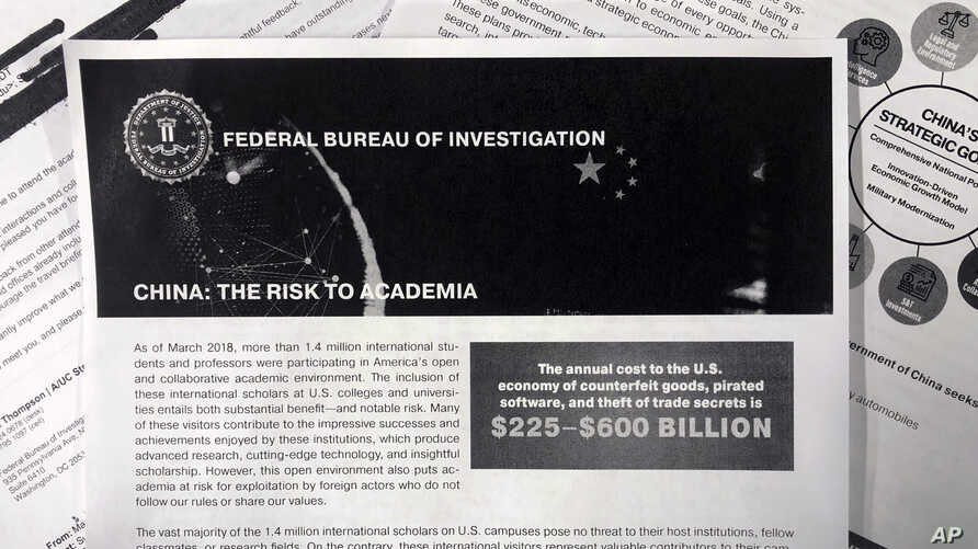 A photo shows a copy of an FBI pamphlet and related emails, Oct. 4, 2019. The FBI's outreach to American colleges about the threat of economic espionage includes this pamphlet that warns specifically about efforts by China to steal academic research.
