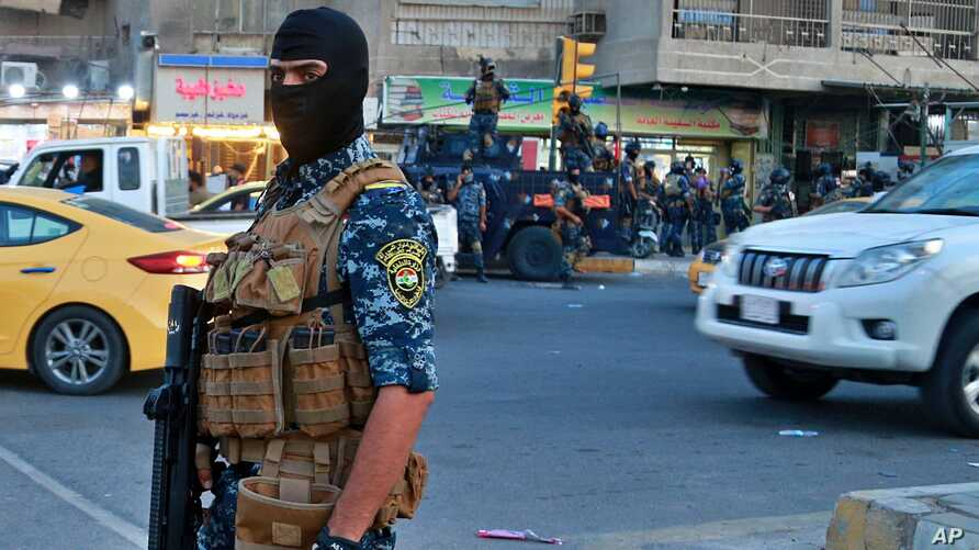 Iraqi Federal police deployed in Sadr City, Baghdad, Iraq, Monday, Oct. 7, 2019. Iraq's prime minister on Monday ordered the…