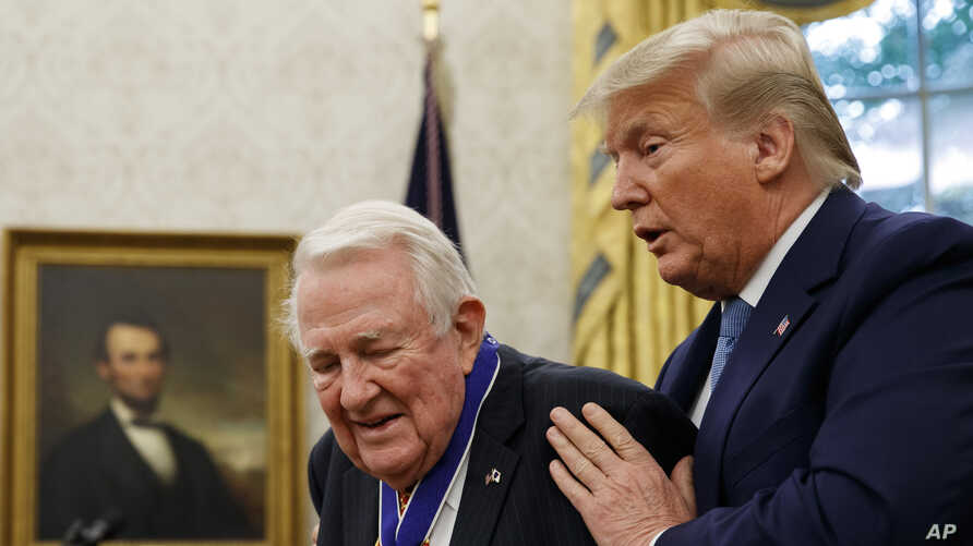 President Donald Trump presents the Presidential Medal of Freedom to former Attorney General Edwin Meese, in the Oval Office of…