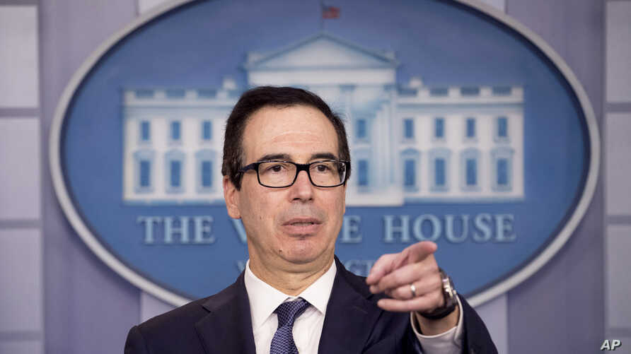 Treasury Secretary Steven Mnuchin takes a question from a reporter after announcing the threat of sanctions on Turkey in the…
