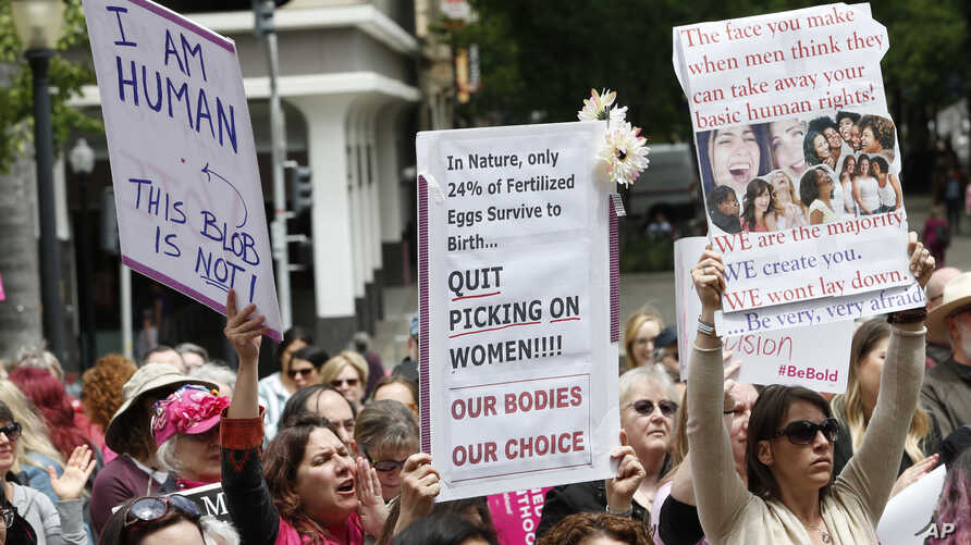 FILE - In this May 21, 2019 file photo, people rally in support of abortion rights at the Capitol in Sacramento, Calif. Gov…