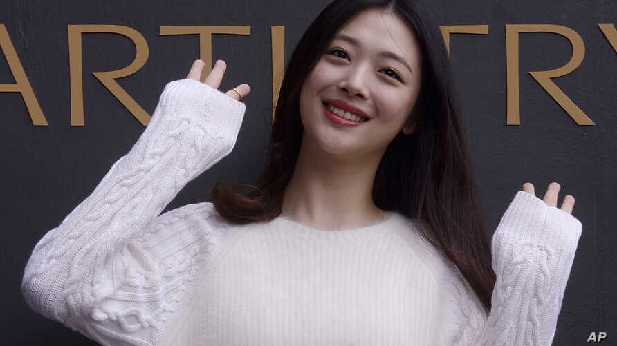 FILE - South Korean pop star and actress Sulli poses during the K-Beauty Close-Up event in Seoul, South Korea, Sept. 30, 2015. News reports on Monday, Oct. 14, 2019, say Sulli has been found dead at her home south of Seoul.