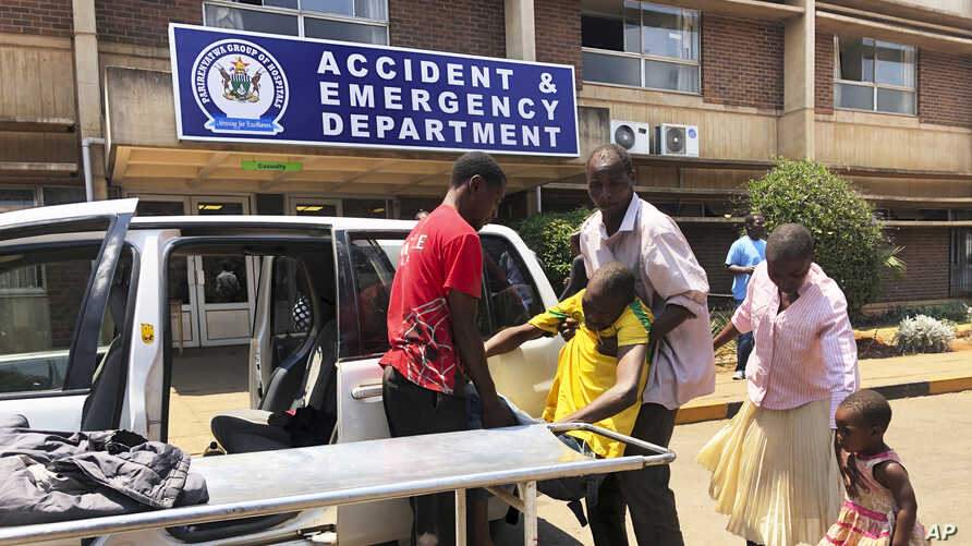 A family brings a sick relative to Parerenyatwa Hospital in Harare, Monday, Oct, 14, 2019. Zimbabwean doctors have been on…