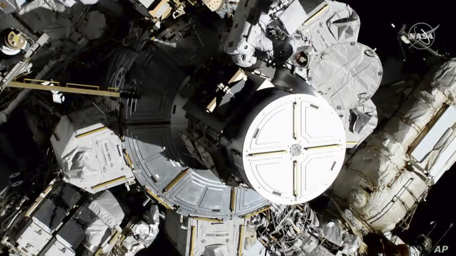 In this photo provided by NASA astronauts Christina Koch and Jessica Meir exits the International Space Station on Friday, Oct…