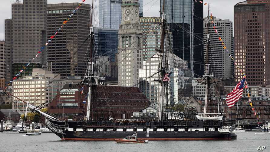 The USS Constitution moves past the skyline in Boston, Friday, Oct. 18, 2019. The ship is making a tour of Boston Harbor in…
