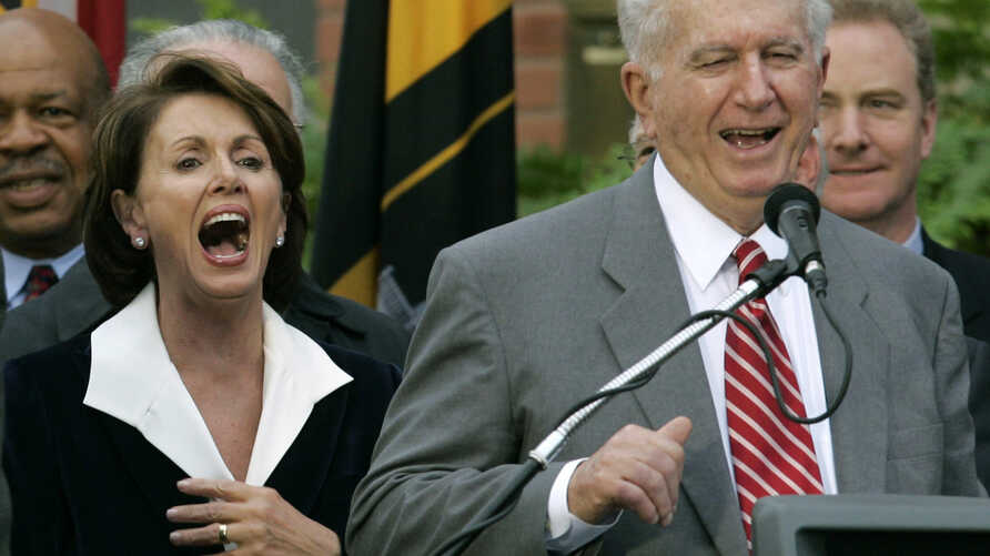 FILE - Speaker of the House Nancy Pelosi, D-Calif., left, laughs as her brother Thomas D' Alesandro III, right, makes a joke as he introduces her husband Paul, during a street renaming ceremony in her behalf, in Baltimore, Jan. 5, 2007.