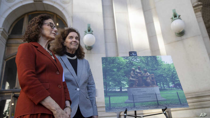 Sculptor Meredith Bergmann, left, stands next to an artist's rendering of her Woman's Rights Pioneer Monument, and Coline…