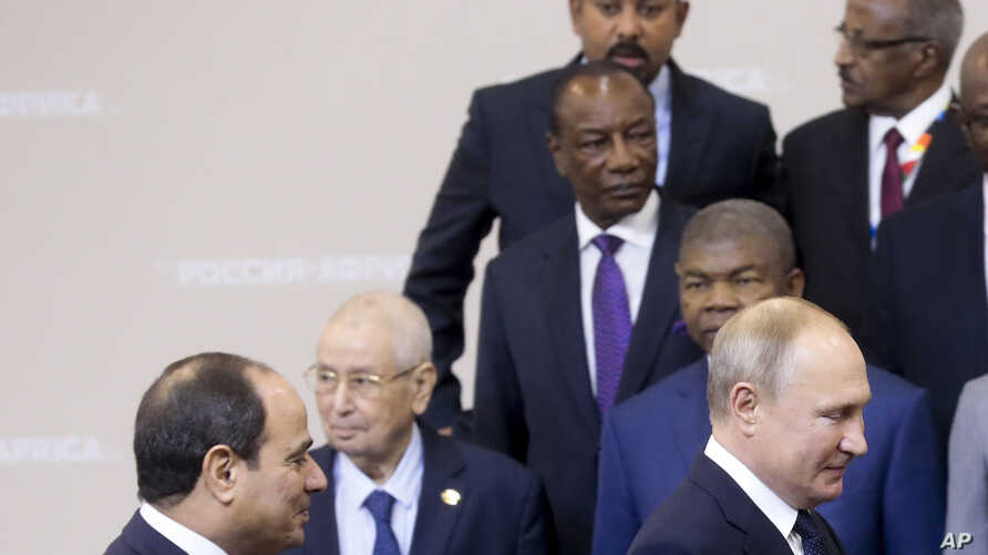 Ethiopian Prime Minister Abiy Ahmed, top center, looks as Egyptian President Abdel-Fattah el-Sissi, bottom left, and Russian President Vladimir Putin, bottom right, at the Russia-Africa summit in the Black Sea resort of Sochi, Russia, Oct. 24, 2019.