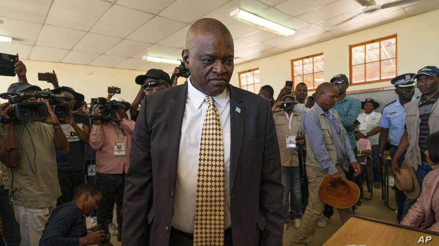 FILE - In this Oct. 23, 2019, file photo, Botswana President Mokgweetsi Masisi arrives to vote in Botswana's general elections…