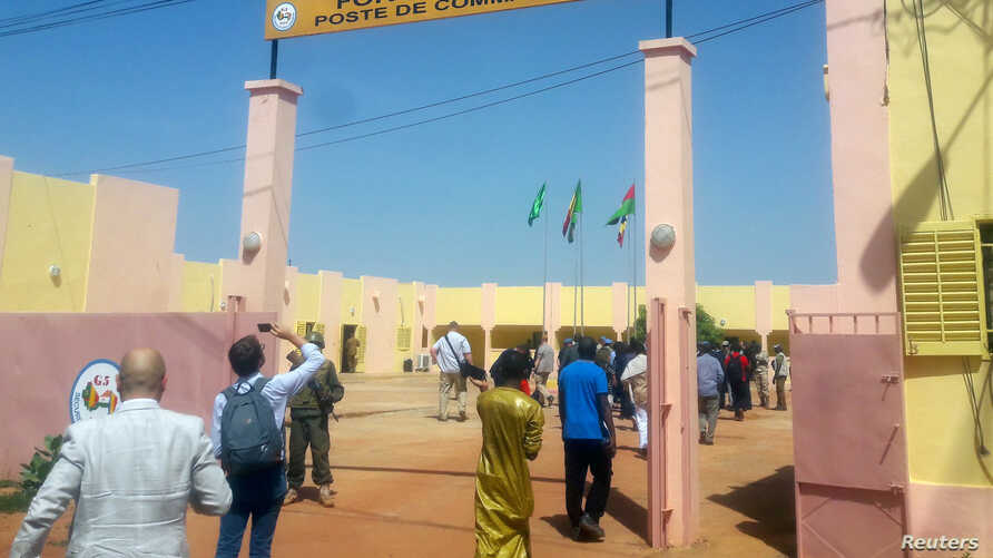 People enter the G5 Sahel force's new military headquarters in Sevare, in central Mali October 22, 2017. Picture taken October…