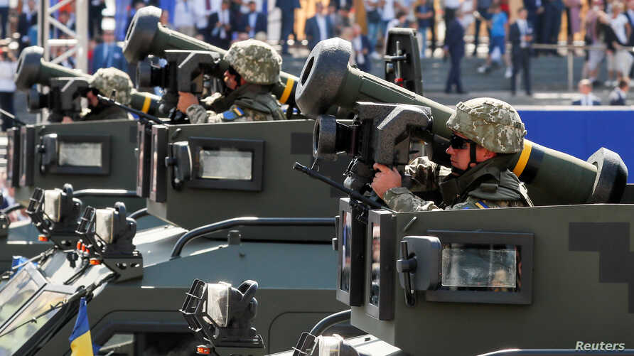 Ukrainian soldiers ride with Javelin anti-tank missiles during a military parade marking Ukraine's Independence Day in Kyiv, Aug. 24, 2018.