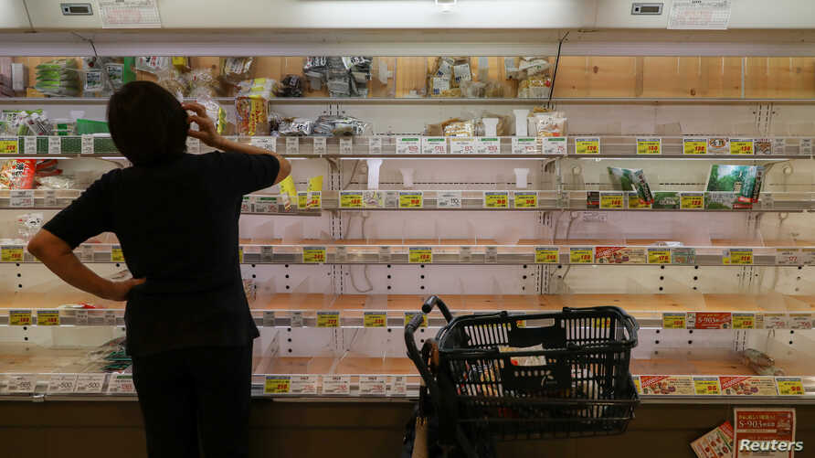 Near empty shelves at a supermarket as people rushed to stock up in preparation for Typhoon Hagibis in Tokyo, Japan October 11,…
