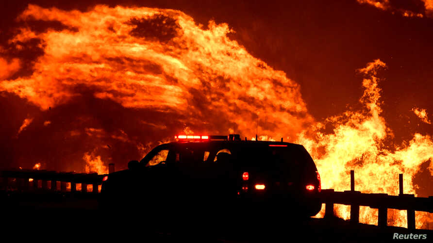 A wind driven wildfire continues to burn in Canyon Country north of Los Angeles, California, U.S. October 25, 2019. REUTERS…
