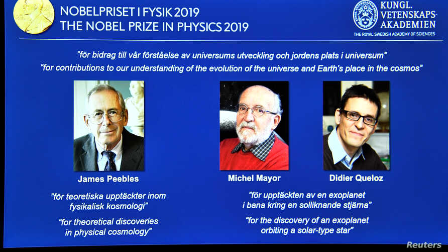 A screen displays the portraits of the laureates of the 2019 Nobel Prize in Physics (L-R) James Peebles, Michel Mayor and Didier Queloz, during a news conference at the Royal Swedish Academy of Sciences in Stockholm, Sweden, October 8, 2019.