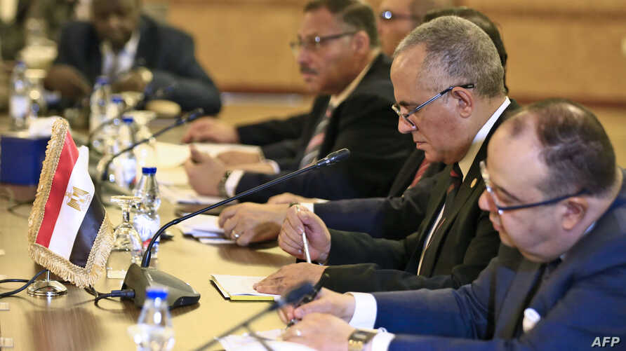 """Egyptian Water Resources Minister Mohamed Abdel Aati (2nd R) participates with a delegation in the """"Renaissance Dam"""" trilateral negotiations with his Sudanese and Ethiopian counterparts (unseen) in the Sudanese capital Khartoum, Oct. 4, 2019."""