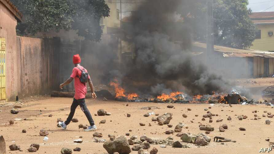 Protesters burn barricades and tires in Conakry street during a demonstration in Guinea.