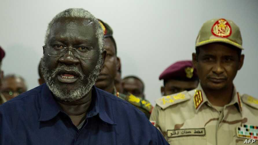 Sudan People Liberation Movement-North (SPLM-North) leader Malik Agar (L) speaks as Sudanese Deputy head of the Transitional Military Council, General Mohamed Hamdan Daglo (R), looks on during a press conference in Juba, South Sudan, July 27, 2019.