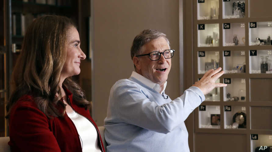 FILE - Bill and Melinda Gates are interviewed in Kirkland, Washington, Feb. 1, 2019. The philantropist couple has teamed up with the U.S. government to more forcefully tackle HIV and sickle cell disease.