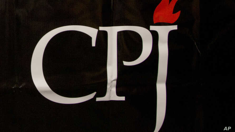 FILE - The CPJ logo is seen on a banner at a media conference in Brussels, Belgium, Sept. 29, 2015.