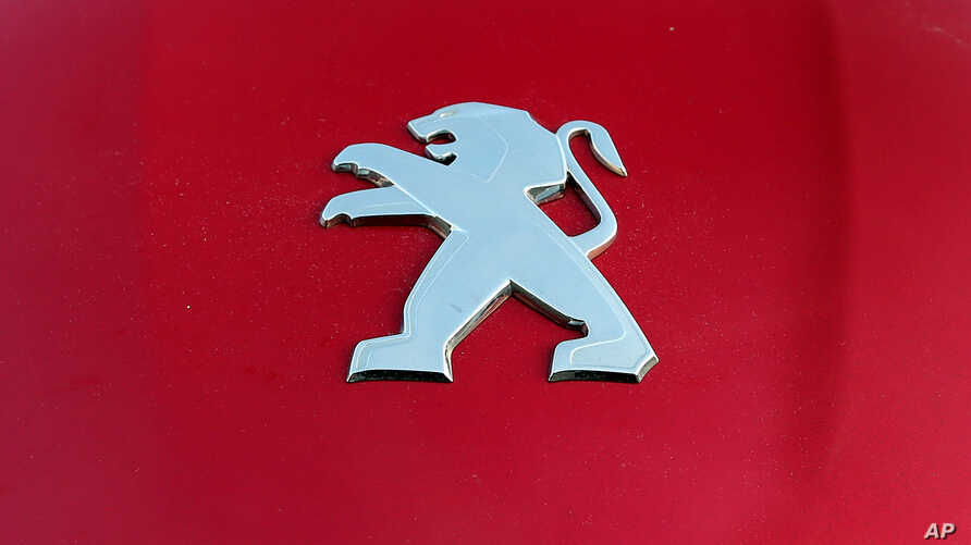 A Peugeot logo pictured on a car in Bayonne, southwestern France, Oct.31, 2019.