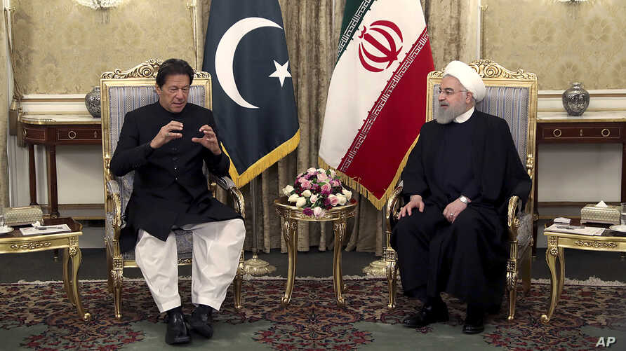 In this photo released by the official website of the office of the Iranian Presidency, Pakistani Prime Minister Imran Khan, left, talks with Iranian President Hassan Rouhani during their meeting at the Saadabad Palace, in Tehran, Iran, April 22, 2019.