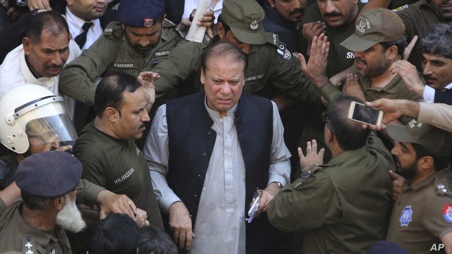 Pakistani former Prime Minister Nawaz Sharif arrives at a court in Lahore, Oct. 11, 2019.