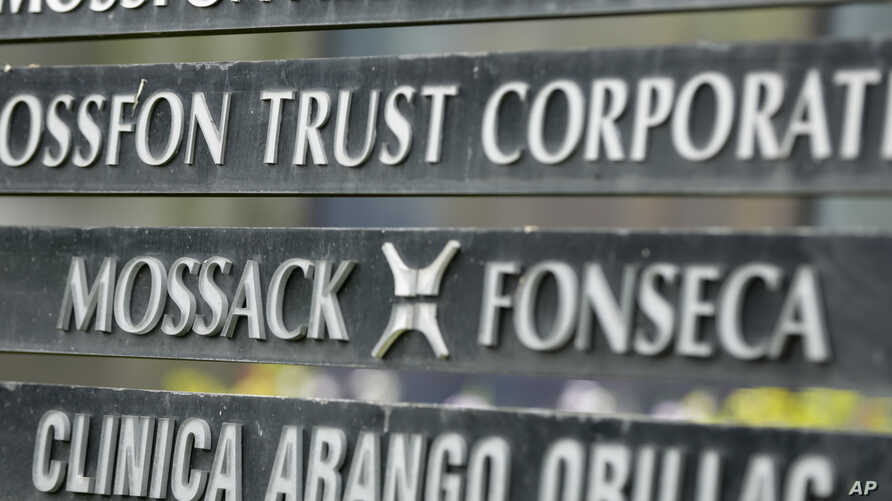 """FILE - A marquee of the Arango Orillac Building lists the Mossack Fonseca law firm  that gained world-wide attention through the so-called """"Panama Papers,"""" in Panama City, Panama, April 4, 2016."""
