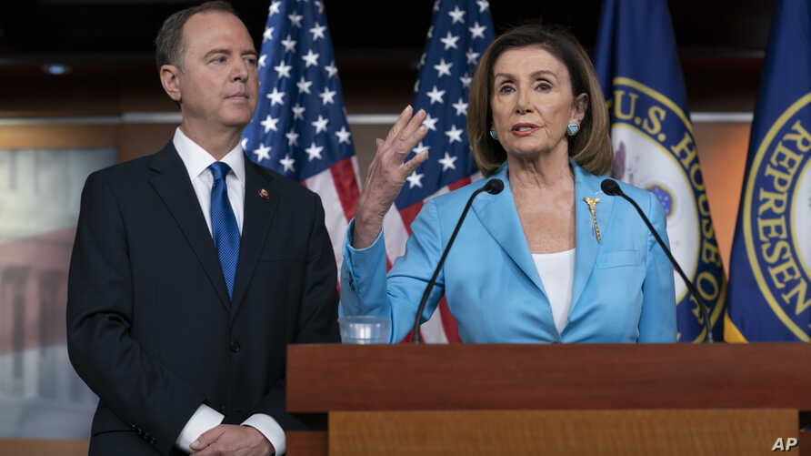 FILE - Speaker of the House Nancy Pelosi is joined by House Intelligence Committee Chairman Adam Schiff at a news conference as House Democrats move ahead in the impeachment inquiry of President Donald Trump, at the Capitol, in Washington, Oct. 2, 2019.