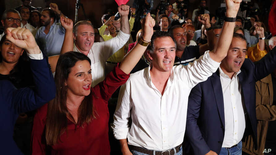 Supporters of Portuguese Prime Minister and Socialist Party leader Antonio Costa react following the announcement of first election results in Lisbon, Oct. 6, 2019.
