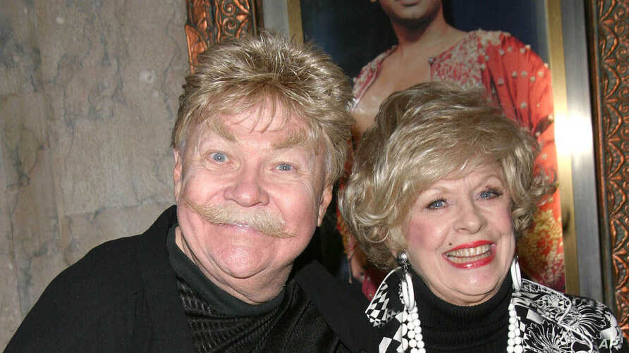 """FILE - Comedian Rip Taylor (L) and a guest at the opening of """"The King And I"""" in Hollywood, California, April 5, 2005."""