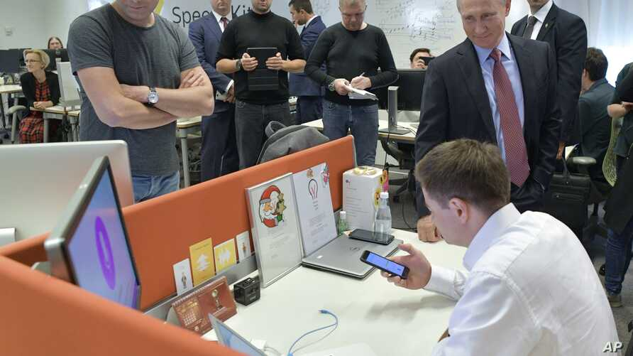 FILE - In this Thursday, Sept. 21FILE - Russian President Vladimir Putin, right, visits the country's largest internet search engine Yandex headquarters in Moscow, Sept. 21, 2017., 2017 file photo, Russian President Vladimir Putin, right, visits Russia's largest internet…