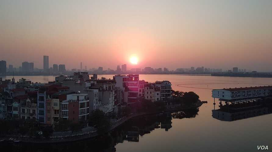 The sun sets in Hanoi, where growing demand for housing puts Vietnam at risk of the affordability issues seen in countries from Japan to Sweden.