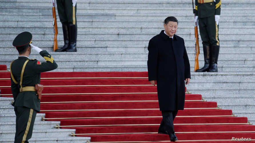 FILE - Chinese President Xi Jinping arrives for a ceremony at the Great Hall of the People, in Beijing, China, Oct. 25, 2019.