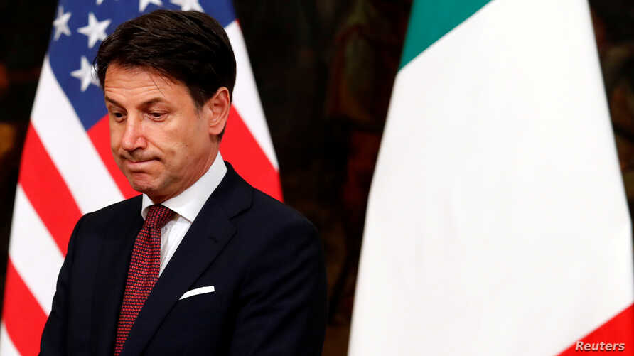 FILE - Italian Prime Minister Giuseppe Conte waits for U.S. Secretary of State Mike Pompeo in Rome, Italy, Oct. 1, 2019.