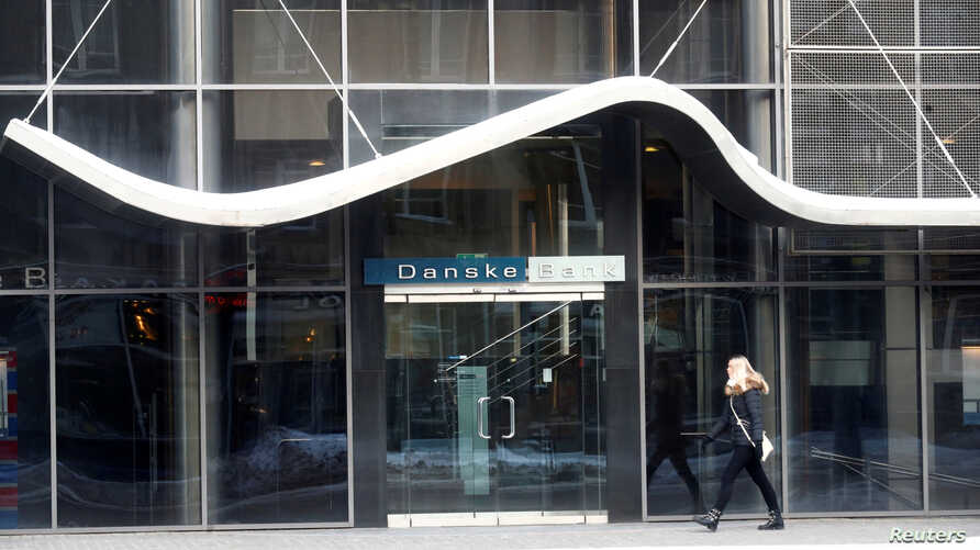 FILE - A woman walks past Danske Bank's Estonian branch, in Tallinn, Estonia, Jan. 22, 2019.