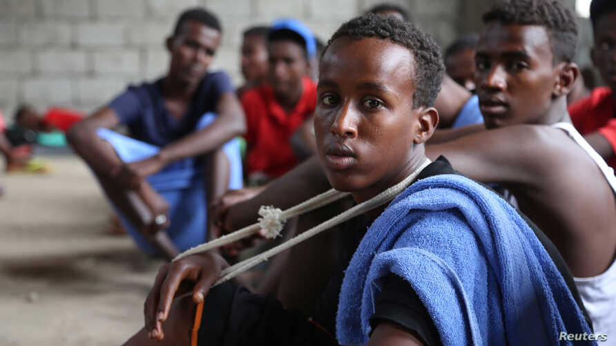 FILE - A group of Somali refugees is seen in Hodeidah, Yemen, March 22, 2017.