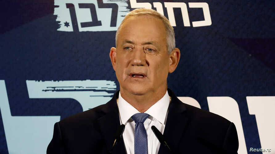 FILE - Benny Gantz, leader of Blue and White party, delivers a statement at the start of his party faction meeting in Tel Aviv, Israel, Sept. 26, 2019.