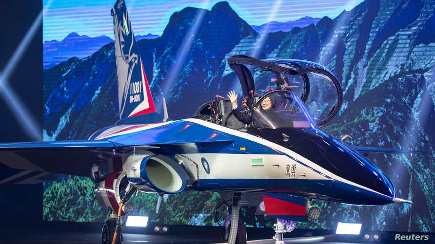 """Taiwan's President Tsai Ing-wen attends an unveiling ceremony for a prototype of advanced jet trainer """"Brave Eagle"""" in Taichung, Sept. 24, 2019. (Military News Agency/Handout)"""