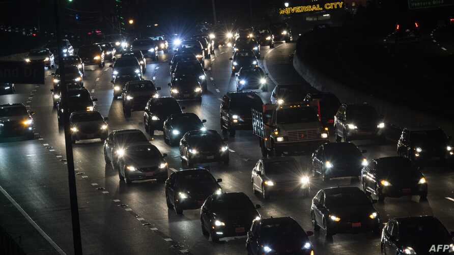 Motor vehicles drive on the 101 freeway in Los Angeles, California on September 17, 2019. - US President Donald Trump is…