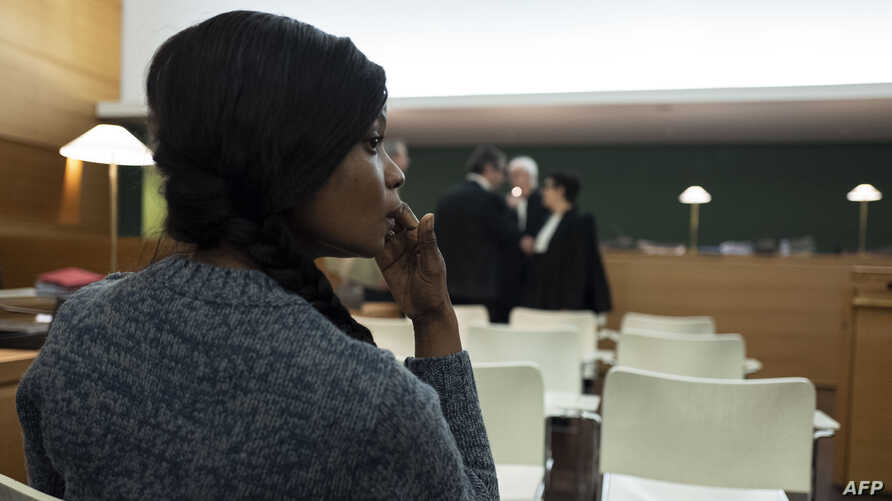 A Nigerian defendant waits in the courtroom prior to the start of a trial of a prostitution network case in Lyon, central…