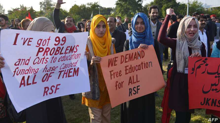 Students display placards during a demonstration demanding for reinstatement of student unions, education fee cuts and batter education facilities, in Islamabad on Nov. 29, 2019.