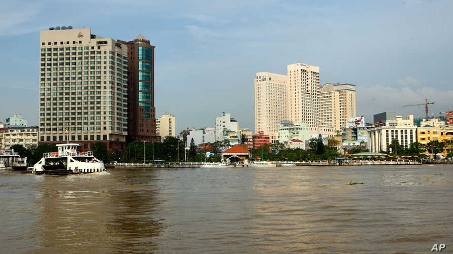 In this Sept. 23, 2009 photo, a riverside view of Ho Chi Minh city center that is located along the Saigon River in Vietnam is…