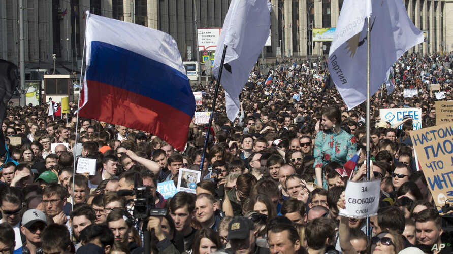 Protesters gather at a central street to rally against authorities' move to block parts of the internet in Russia in Moscow,…