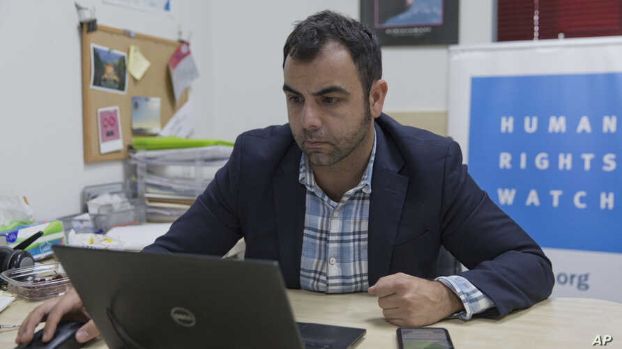 Omar Shakir, the local director of Human Rights Watch, works at his office in the West Bank city of Ramallah, Tuesday, Nov. 5,…