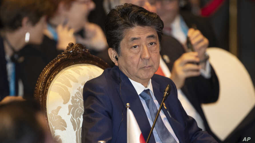 FILE - This Nov. 4, 2019, file photo, Japan's Prime Minister Shinzo Abe, attends East Asia summit in Nonthaburi, Thailand…