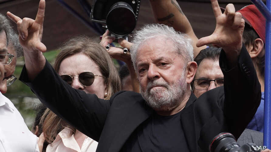 Former Brazilian President Luiz Inacio Lula da Silva acknowledges supporters during a rally at the Metal Workers Union…