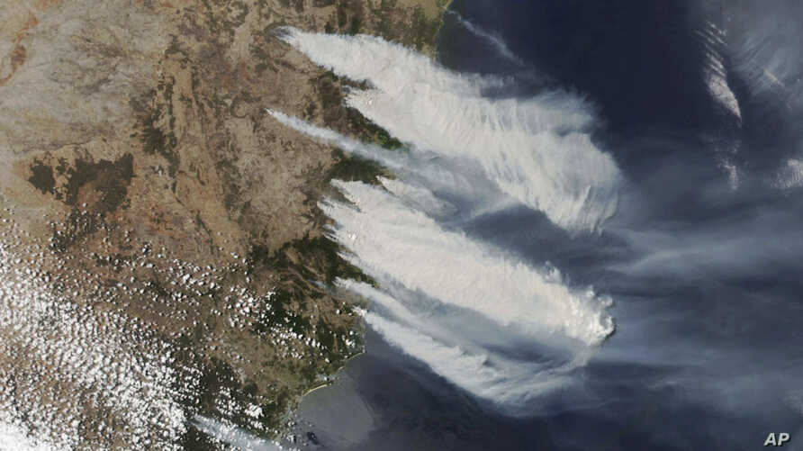 This Nov. 8, 2019, satellite photo taken by NASA shows hot, dry and windy weather conditions as bushfires burn in the eastern…