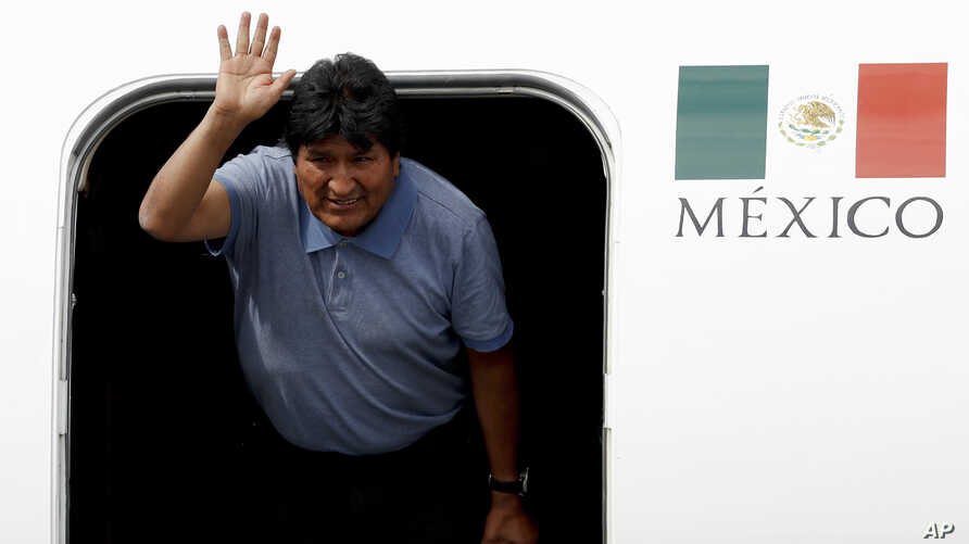 Former Bolivian President Evo Morales waves upon arrival to Mexico City, Tuesday, Nov. 12, 2019. Mexico granted asylum to…