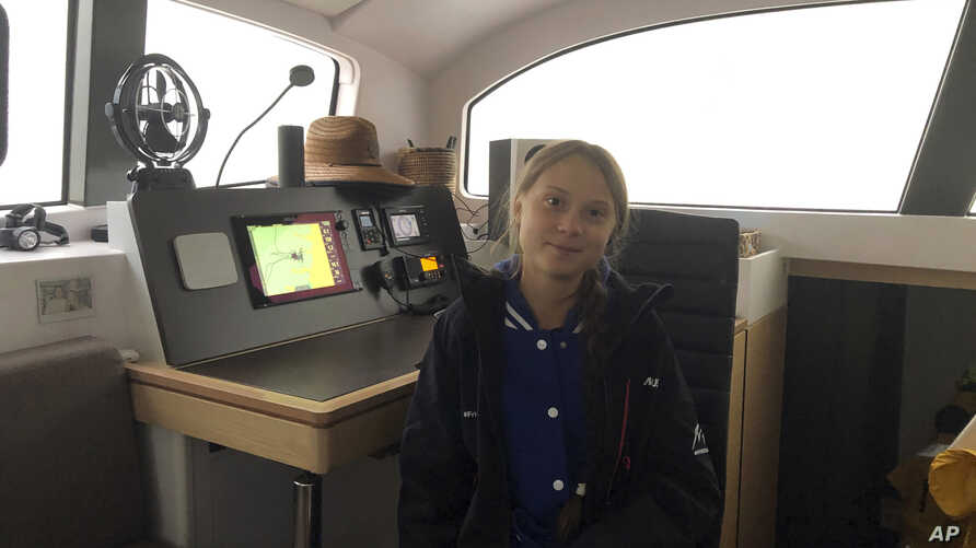 Greta Thunberg, a 16-year-old climate activist from Sweden, sits on a catamaran docked in Hampton, Virginia, Nov. 12, 2019.