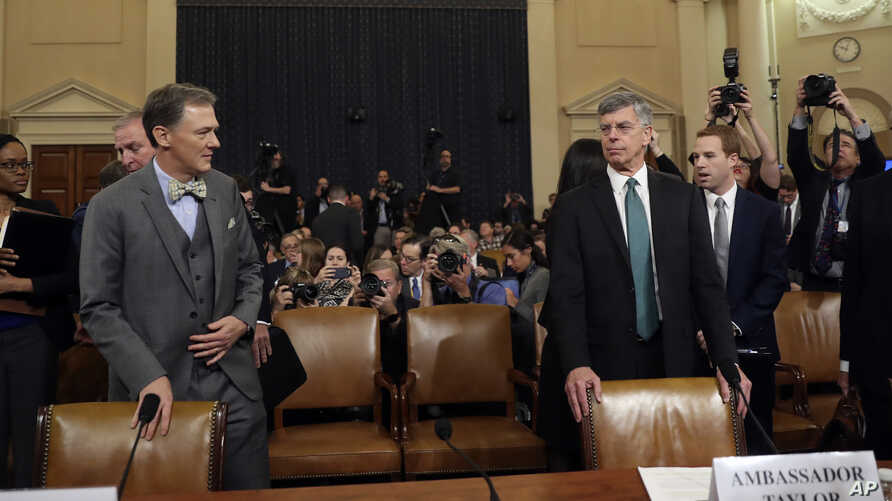 Top U.S. diplomat in Ukraine William Taylor, and career Foreign Service officer George Kent, left, arrive to testify before the…
